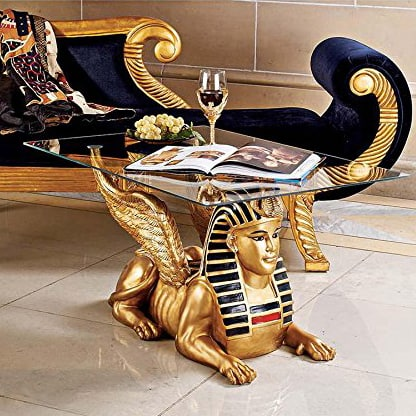 Egyptian sphinx glass-topped coffee table