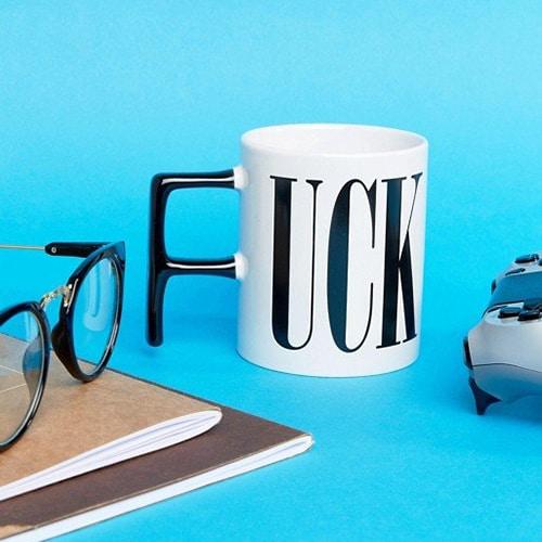 Thumps up *uck mug